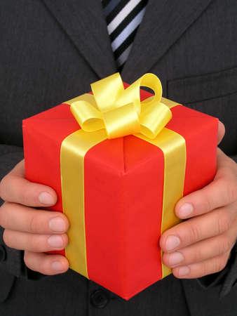 Businessman Holding Gift photo