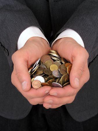 Businessmans Hands Holding Coins photo