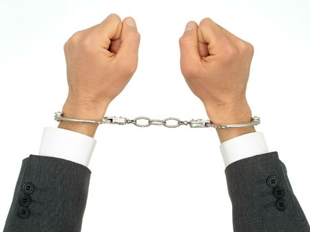 Businessmans Hands In Handcuffs photo