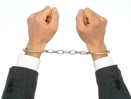 Businessmans Hands In Handcuffs photo