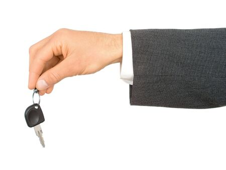 Businessmans Hand Holding Car Key photo