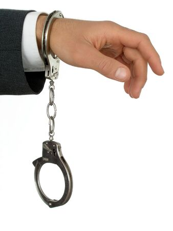 Businessman Wearing Handcuffs photo