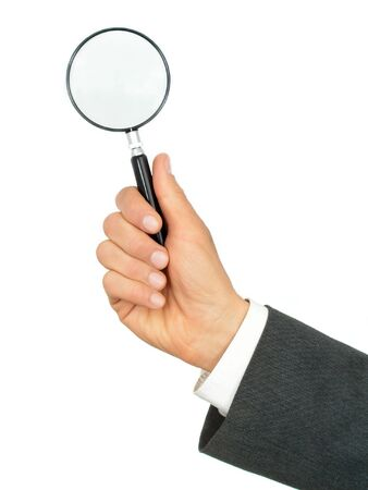 Hand Holding Magnifying Glass photo