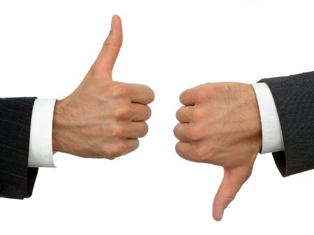 Businessmens hands, one thumbs-up, one thumbs-down photo