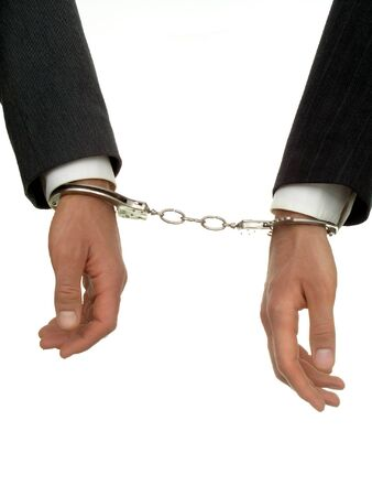 Businessmens hands In Handcuffs photo