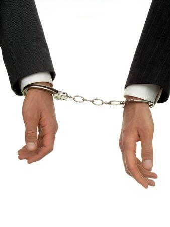 Businessmens hands In Handcuffs photo