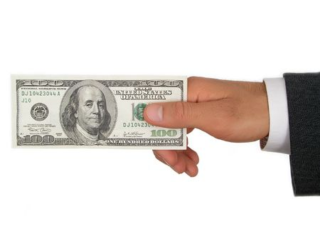 Businessman's Hand Holding One Hundred Dollar Bill photo