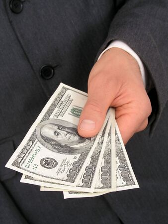 Businessman Offering Money photo