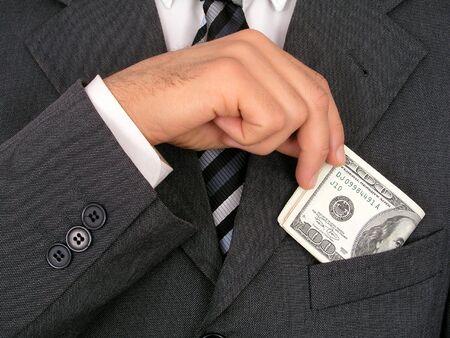 Businessman Putting Money Into Pocket Reklamní fotografie