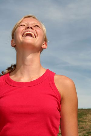 Woman laughing against blue sky Stock Photo - 484809