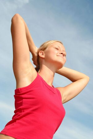 Woman stretching in sunlight Stock Photo - 484803