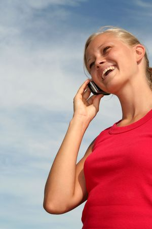 Happy young woman using a mobile phone Stock Photo - 484784