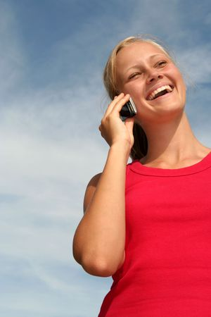 Happy young woman using a mobile phone Stock Photo - 484788