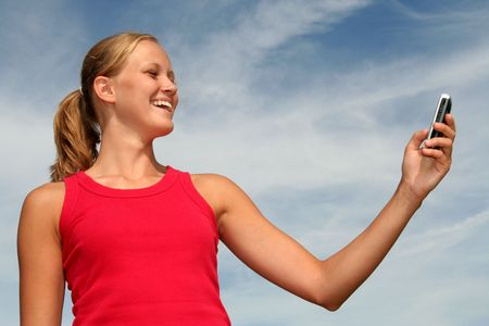 Happy young woman using a mobile phone Stock Photo - 484787
