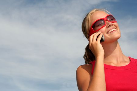Happy young woman using a mobile phone Stock Photo - 484786