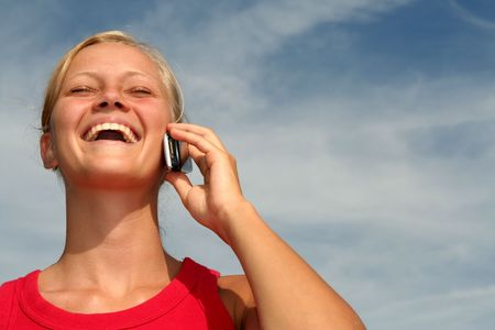 Happy young woman using a mobile phone Stock Photo - 484785