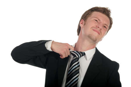 Businessman loosening his tie Stock Photo