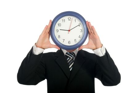 Businessman holding clock in front of his face photo