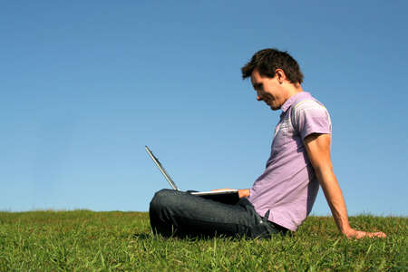 Young Man Working on Laptop Outdoors Stock Photo - 578988