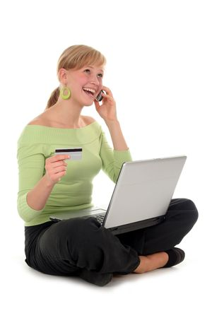 Woman shopping online, talking on the phone Stock Photo - 578998