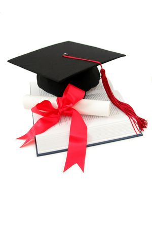 mortarboard: Graduation cap and diploma on a book Stock Photo