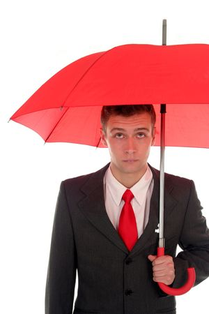 Businessman holding an umbrella photo
