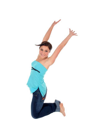 Happy woman jumping Stock Photo - 689705
