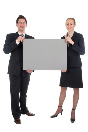 Businesswoman and businessman holding poster board