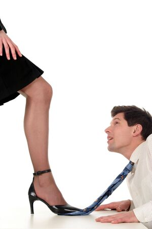 stepping: Businesswoman dominating businessman