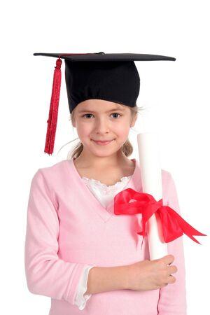 Little girl in graduation cap Stock Photo