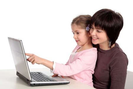 blonde mom: Mother and Daughter Using Laptop