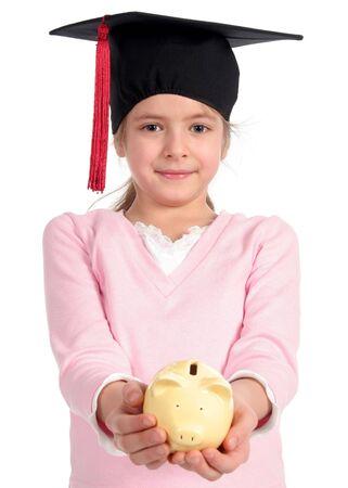 mortarboard: Girl in graduation cap holding piggy bank
