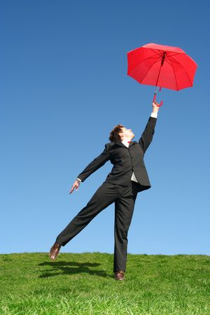 Businessman Outdoors Holding an Umbrella  photo