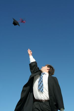 Young man tossing up his hat on Graduation Day Stock Photo - 872575