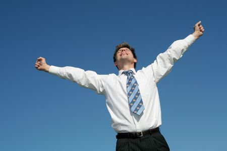 Businessman with Arms Outstretched photo