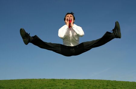 Businessman jumping and shouting photo