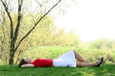 Woman lying down in the park Stock Photo - 907044