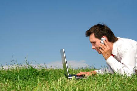 Young man using laptop outdoors