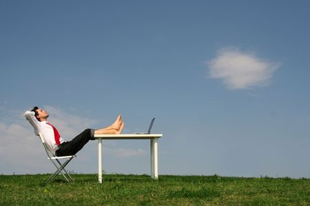 Businessman using laptop outdoors