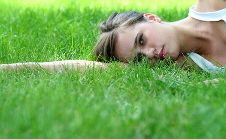 Beautiful young woman lying on a lawn  Stock Photo - 1328463