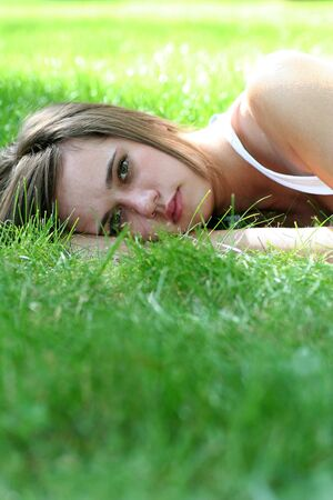 Beautiful young woman lying on a lawn  Stock Photo - 1328462