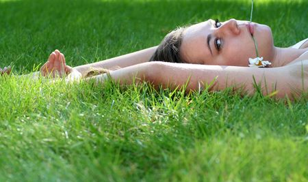 Woman lying on grass Stock Photo - 1328467
