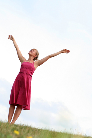 Woman standing with arms raised Stock Photo - 1432415
