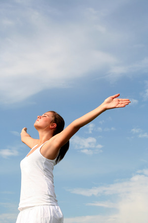 arms wide: Woman with arms outstretched  Stock Photo