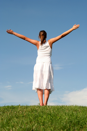 hands raised: Woman with arms outstretched  Stock Photo