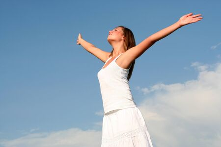 arms outstretched: Woman spreading arms to sky Stock Photo