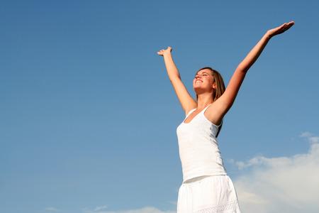 Woman spreading arms to sky Stock Photo - 1478818
