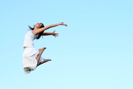 freetime: woman jumping  Stock Photo