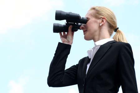 Businesswoman looks into the future Фото со стока