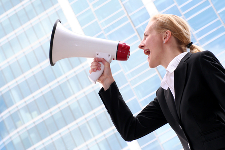 Businesswoman Using a Megaphone photo